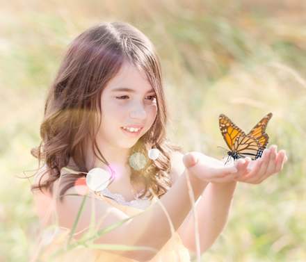 Young girl taking part in an Oklahoma butterfly release.