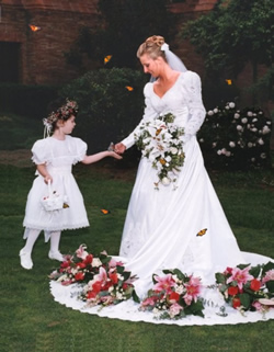 bride & flower girl sharing a butterfly release in Springfield Massachusetts.
